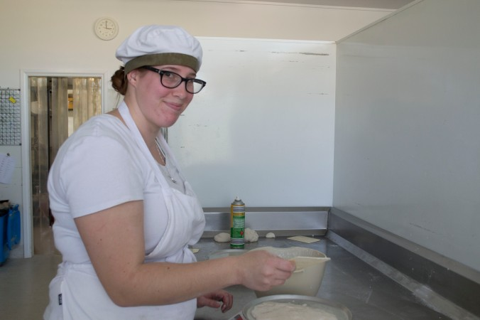 Casey the baker, whipping up some delicious gluten free dough at the Healthy Loaf Bakery
